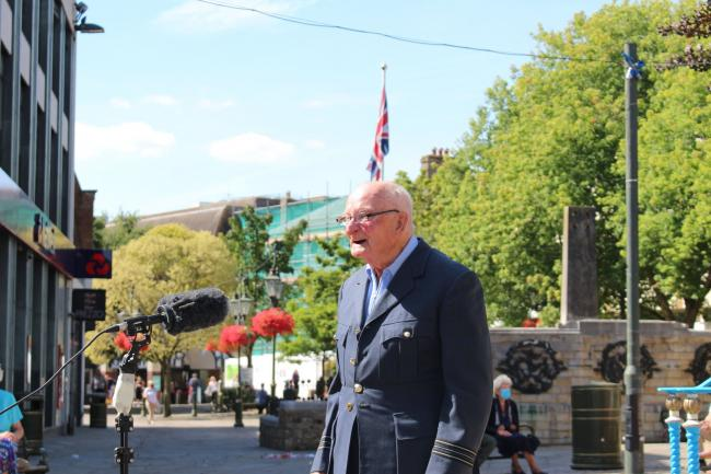Veteran Alan Alan Woolven from Horsham's Carfax bandstand performed for VJ Day in Horsham