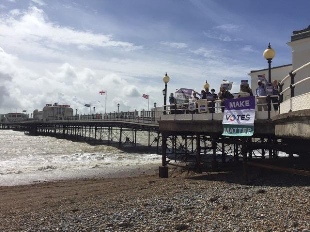 The Argus: Protesters assembled on Worthing Pier
