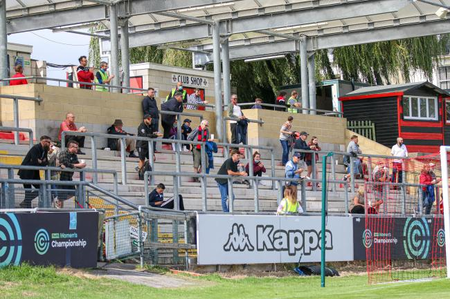 Some of the 100 fans who were in attendance at the Dripping Pan on Sunday watch on. Picture: James Boyes.