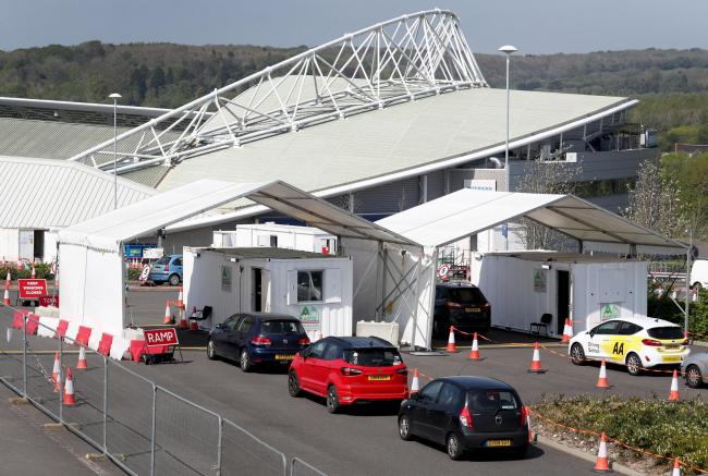 A view cars queueing for the COVID 19 drive-in testing centre in Brighton & Hove Albion's American Express Community Stadium as the UK continues in lockdown to help curb the spread of the coronavirus.as the UK continues in lockdown to help curb th