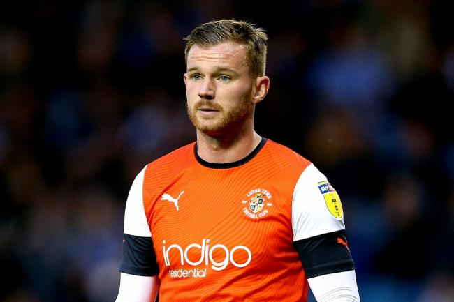 Luton's Ryan Tunnicliffe will come up against former side Manchester United on Tuesday