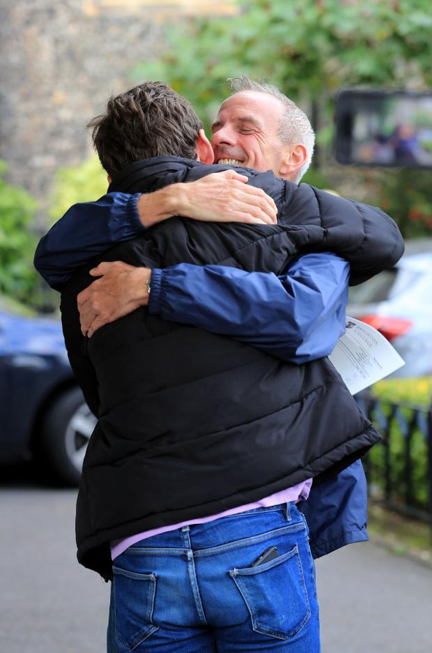 The Argus: Fatboy Slim, real name Norman Cook, congratulates Woody on his GCSE results at Brighton College
