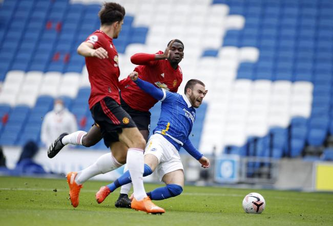 Albion striker Aaron Connolly is fouled by  Manchester United midfielder Paul Pogba in their 3-2 loss at the Amex yesterday