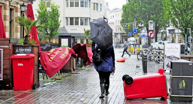 Brighton UK 6th June 2017 - It's a struggle walking with an umbrella through Brighton as storms with high winds and driving rain batter the south coast of Britain today with more unsettled weather forecast for the next few days.Photograph taken by Sim