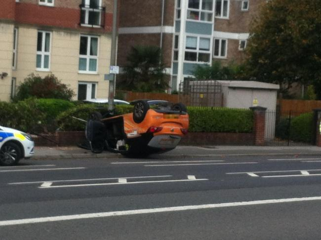 A car flipped on to its roof in a crash on London Road, Brighton, near Withdean Park