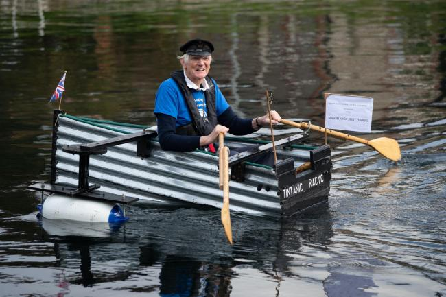 Michael Stanley, also known as 'Major Mick', 80, rows along the Chichester canal, West Sussex