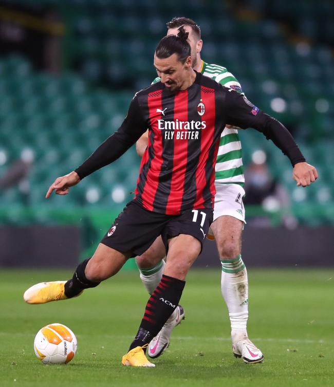 Shane Duffy battles for the ball with AC Milan striker Zlatan Ibrahimovic
