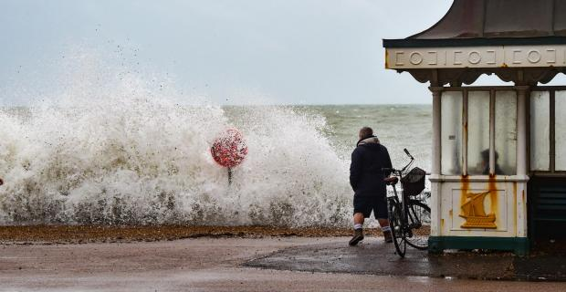 The Argus: Waves batter Brighton and Hove seafront as high winds and heavy rain hit Sussex Credit: Simon Dack