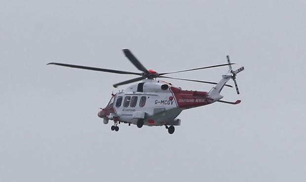 The Argus: The coastguard helicopter was scrambled in the search for the missing fishermen off Newhaven Credit: Eddie Mitchell