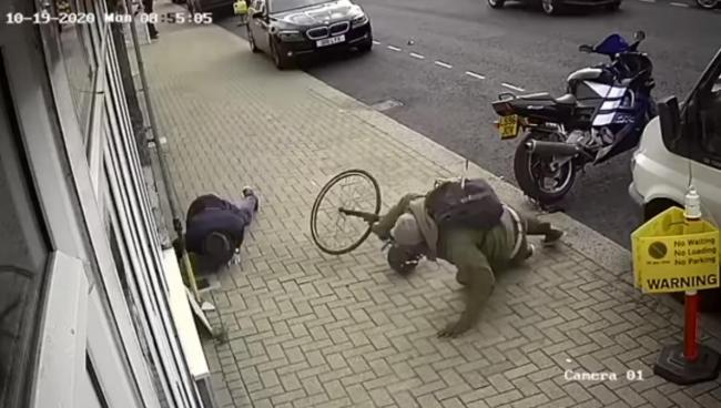 John Wilson was knocked to the floor by a police worker riding his bike on the pavement