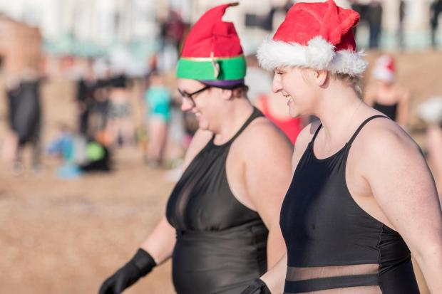 The Argus: Some took to the water sporting Santa hats
