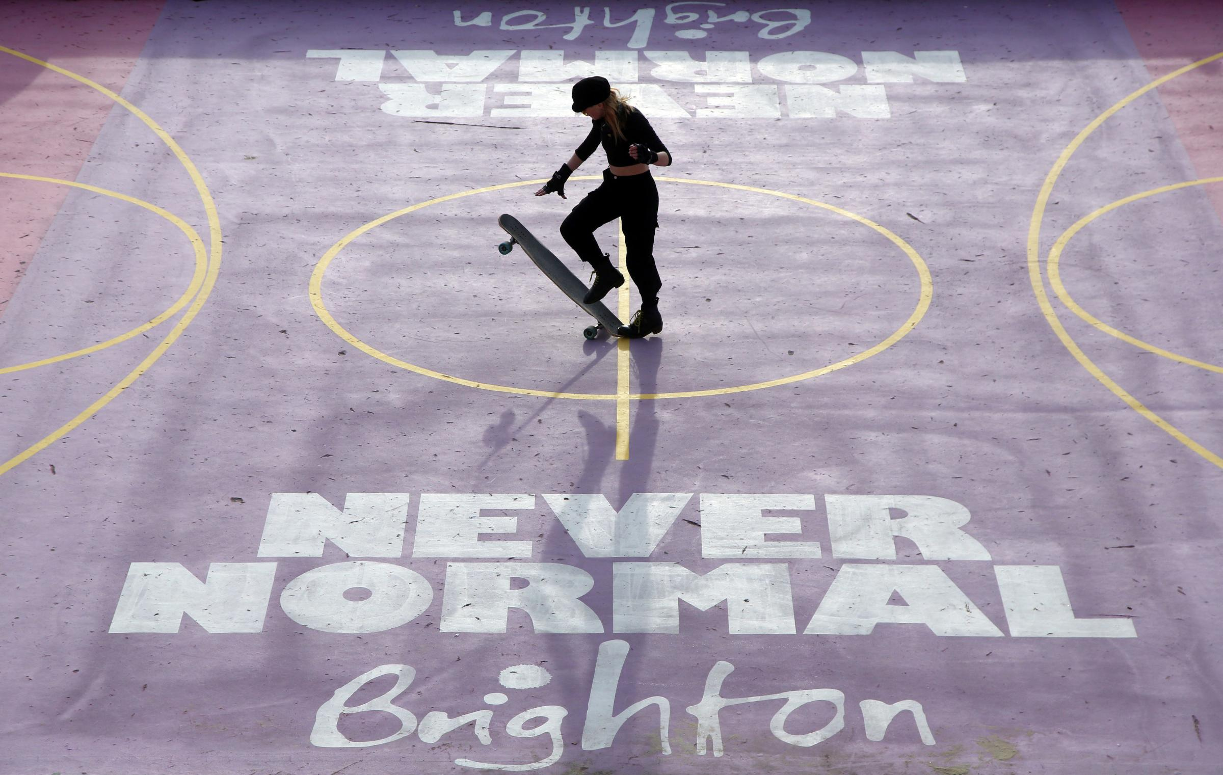 A woman enjoys skateboarding on the seafront in Brighton during Englands third national lockdown to curb the spread of coronavirus. PA Photo. Picture date: Sunday January 17, 2021. Under increased measures people can no longer leave their home without a