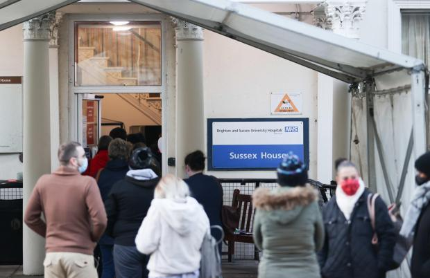 The Argus: NHS staff queuing for the Covid vaccine outside Sussex House in Kemp Town last month