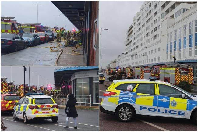 Police, fire and ambulance crews  were called to the A259 on Hastings seafront this morning following reports of a fire in the basement of a large block of flats Credit: @BeamingSteve