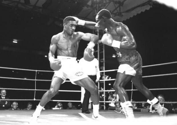 The Argus: Chris Eubank (right) in action against Michael Watson in their title fight at White Hart Lane in September 1991 . Michael Watson was knocked down late in the fight and suffered brain damage