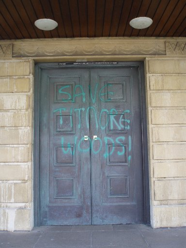GRAFFITI: Save Titnore Woods was daubed on the doors of the Assembly Hall before this afternoon's meeting