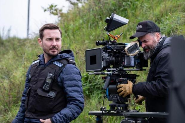 The Argus: Martin Compston during filming of Line of Duty series five. Picture: World Productions/BBC