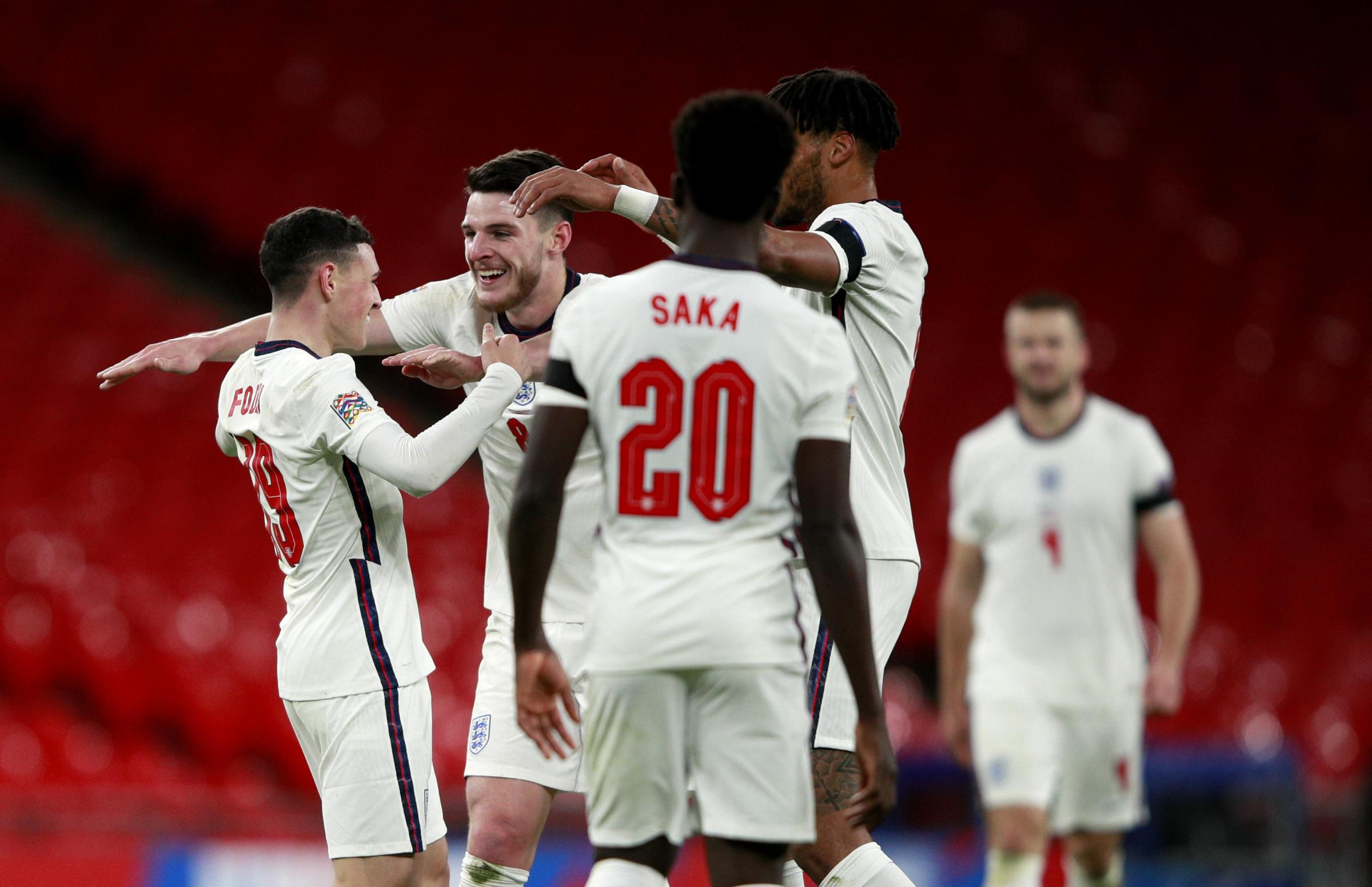 Englands Phil Foden (left) celebrates scoring his sides fourth goal of the game with team-mates during the UEFA Nations League Group A2 match at Wembley Stadium, London. PA Photo. Picture date: Wednesday November 18, 2020. See PA story SOCCER England.