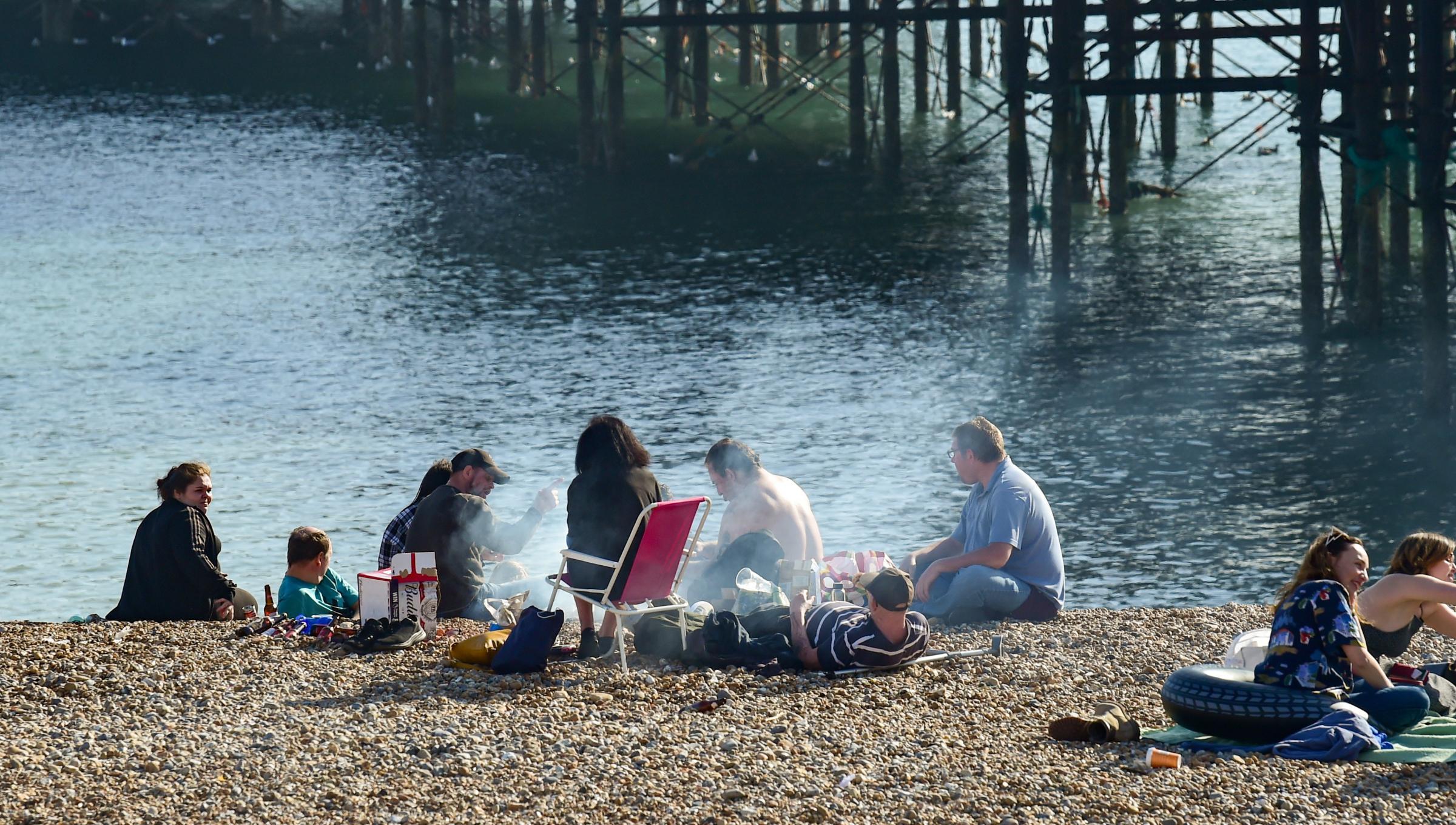 A busy Brighton beach on Tuesday, March 30 Credit: Simon Dack