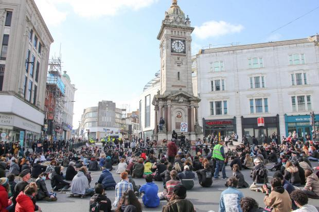 The Argus: The crowd staged a sit-in at the Jubilee Clock Tower, Brighton