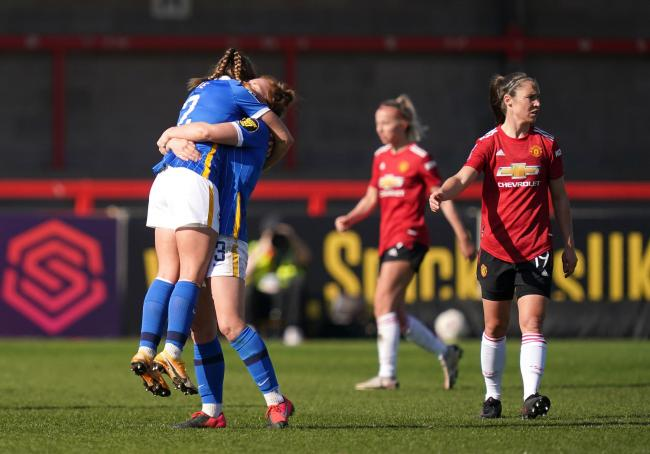 Albion's Fliss Gibbons and Bethan Roe celebrate their win over Manchester United after the final whistle at The People's Pension Stadium