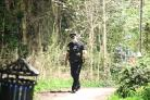 A police officer searches Longcroft Park