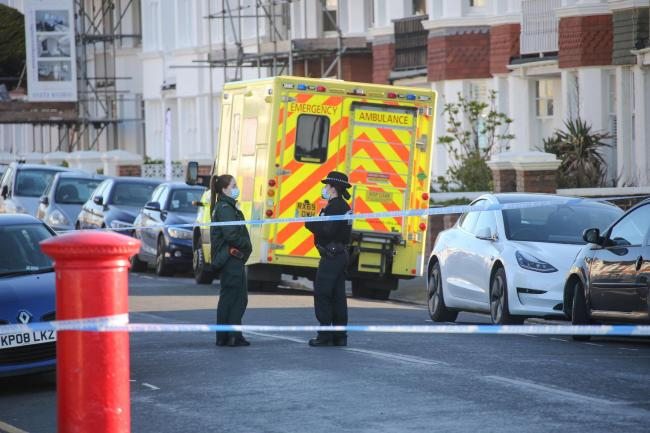 A man who was found by a woman in Langdale Gardens in Hove this morning was confirmed to have died. Photos: Eddie Mitchell