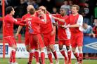 Forrest is mobbed after scoring Crawley's penalty