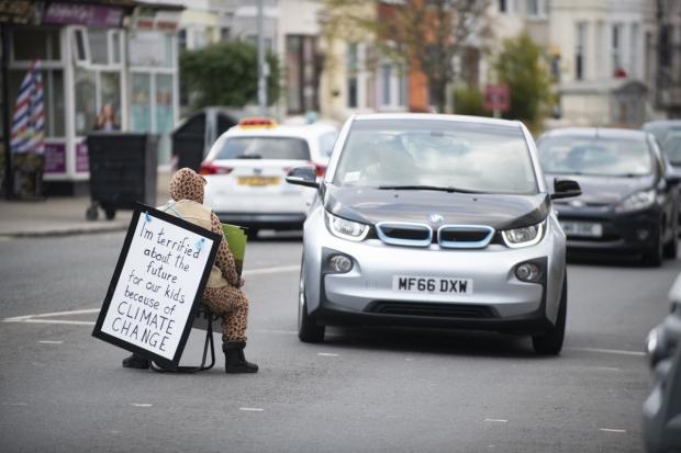 The Argus: An Extinction Rebellion activist in Lewes Road, Brighton. Pictured by Danny Fitzpatrick - DFphotography