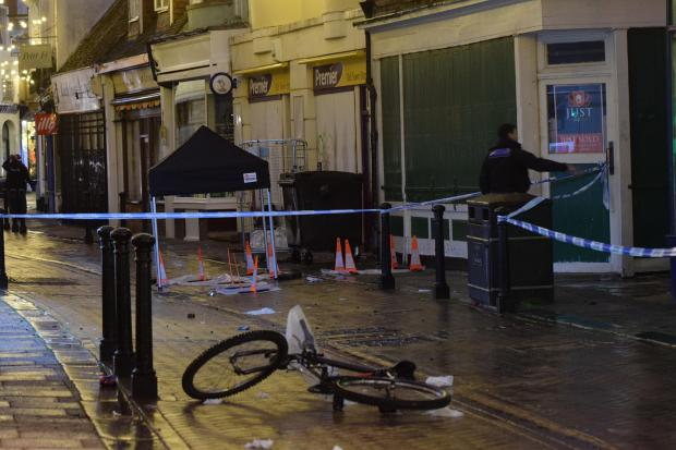 The Argus: Blue police tape marked off a police cordon in Hastings