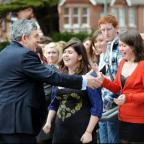 WARM WELCOME: Gordon Brown is greeted by students at BHASVIC this morning