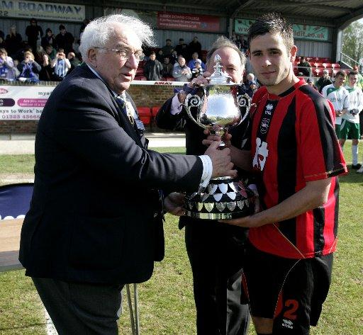 Steve Cook picks up the Senior Cup