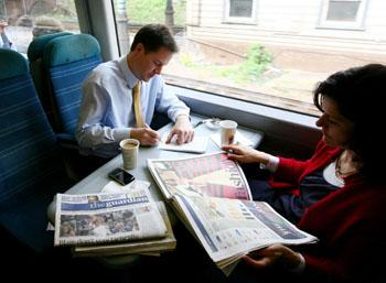 ON BOARD: Nick Clegg travelling to Eastbourne this morning