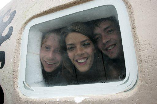 Peter, Natasha and John Wilson look out from the close confines of the egg – their home for a week
