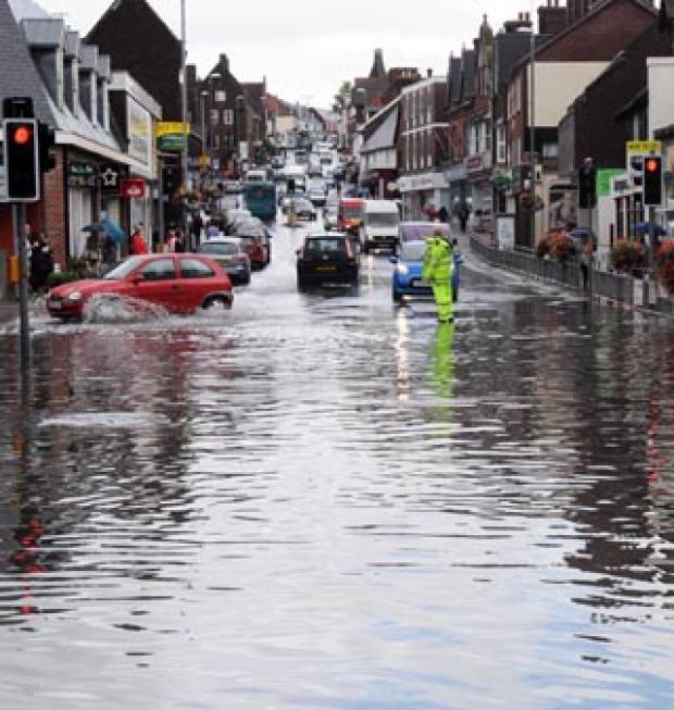 The Argus: DELUGE: Uckfield High Street is underwater this afternoon. Picture by Mike Harvey-Penton