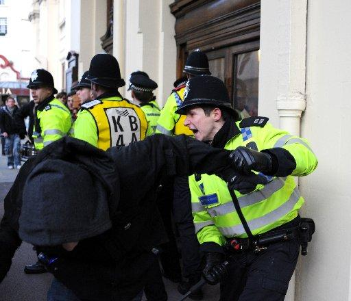 CONTROL: A policeman confronts at protester outside Brighton Town Hall this afternoon.