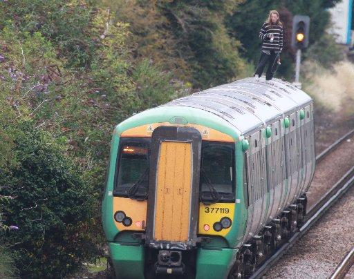 Commuter chaos as Worthing man climbs on train