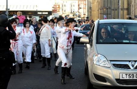 Thousands of zombies made their way through Brighton city centre for the annual Beach of the Dead walk.