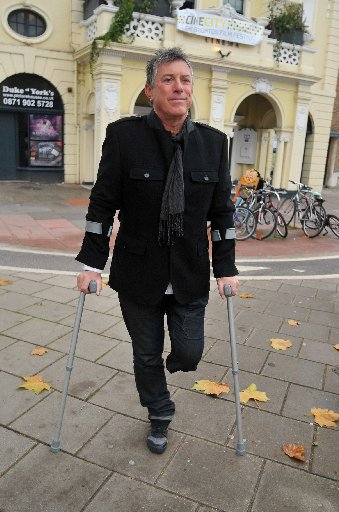 Mick Dabner on his crutches after his wheelchair was stolen