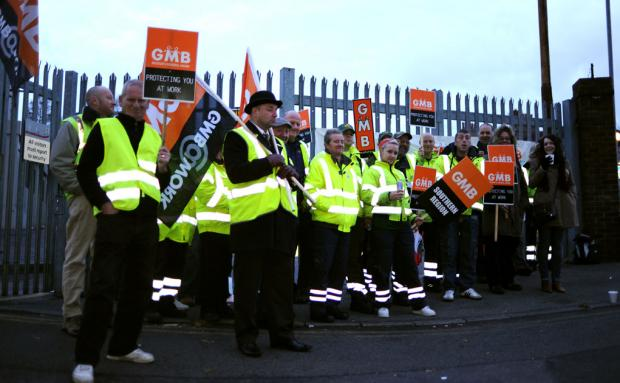 Striking Brighton and Hove City Council workers outside the Hollingdean depot this morning