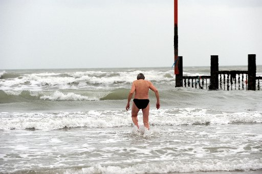 John Kapp wades out to the patch of warm sea water off Shoreham