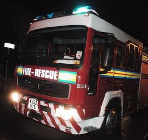 Man escapes after being woken by fire in his kitchen