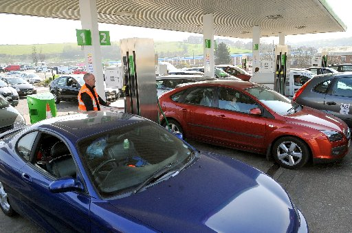 Drivers pictured at Asda petrol station in Hollingbury, Brighton, yesterday