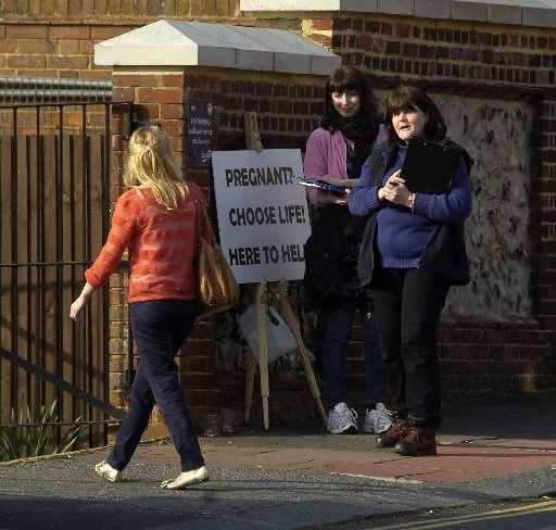 Argus chief reporter Emily Walker is approached by campaigners as she walks into Wistons Clinic in Brighton