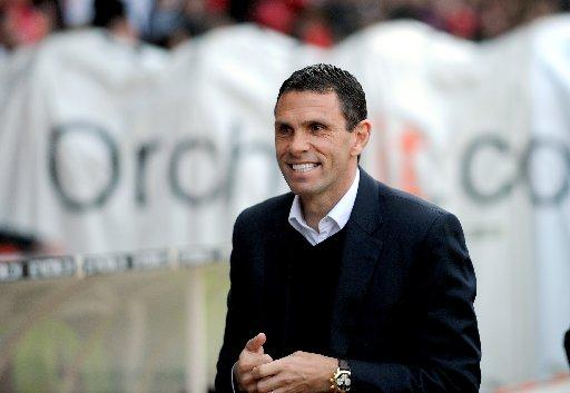 Happy: Gus Poyet