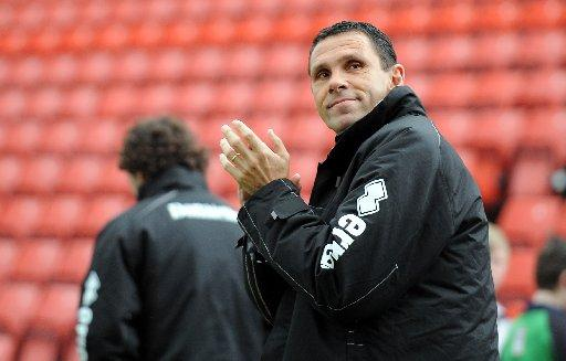 Gus Poyet applauds the fans at Barnsley