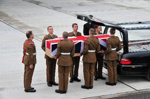 The repatriation of Worthing guardsman Michael Roland at RAF Brize Norton – Richard Watt , MOD/Crown