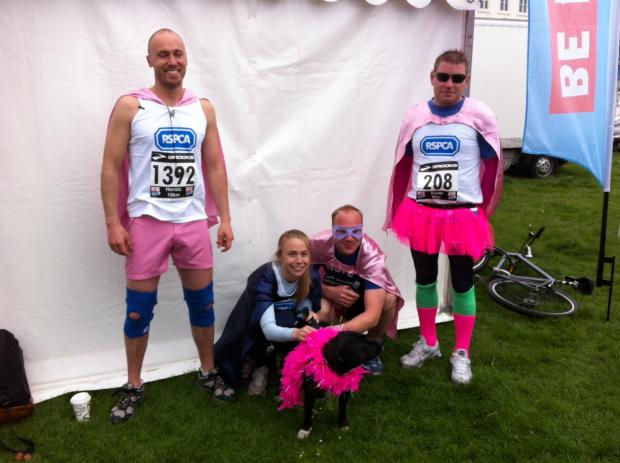 Pretty in pink! From left: Pat Osbourn, Rachel Horton, Rosie the Staffie, Richard Hall and Ian Booth