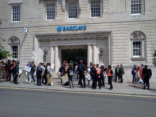 SmashEDO protesters gather outside Barclays Bank in Brighton