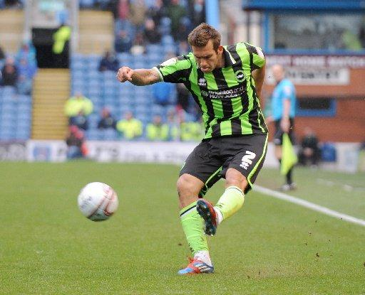 On the run: Joe Mattock crosses for Albion at Burnley last season